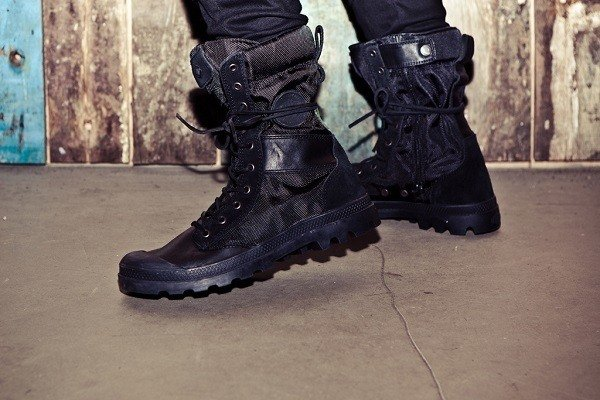 Wearing tactical boots.