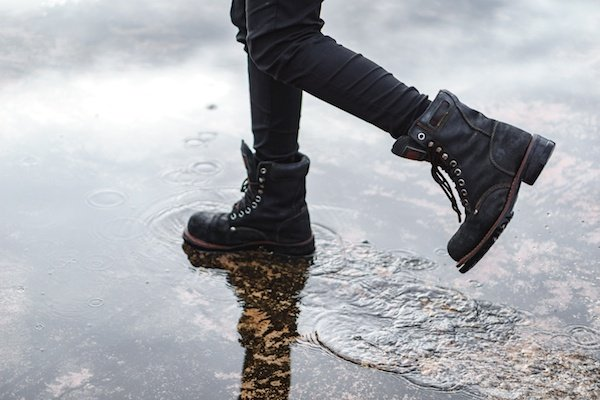 Wearing tactical boots in a puddle.